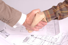 Worker and businessman shaking hands Stock Image
