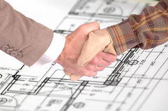 Worker and businessman shaking hands Royalty Free Stock Image