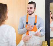 Worker came to call housewife Royalty Free Stock Images