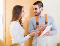 Worker came to call housewife Stock Photography