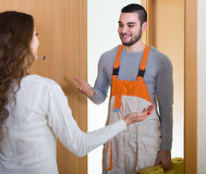 Worker came to call housewife Stock Photo
