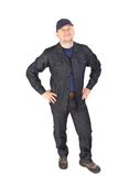 Worker in cap with hands on hips. Royalty Free Stock Image