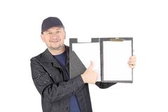 Worker in cap with opened folder. Isolated on a white background Royalty Free Stock Photo