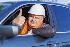 Worker in car showing thumb up Royalty Free Stock Photo