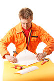 Worker carefully folds a paper stock photography