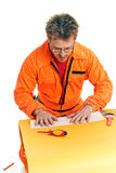 Worker carefully folds a paper sheet Royalty Free Stock Image