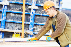 Worker carpenter preparing construction formwork for concreting Stock Photography