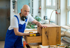 Worker in a carpenter's workshop Royalty Free Stock Image