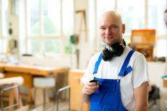 Worker in a carpenter's workshop Royalty Free Stock Images