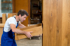 Worker in a carpenters workshop Stock Image