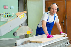 Worker in a carpenters workshop Royalty Free Stock Photography