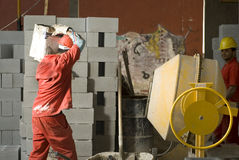 Worker Carries Construction Material - Horizontal Stock Image