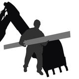 Worker carries material by machine Royalty Free Stock Photos