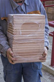 Worker carries packages of beech wood profiles 4 Stock Photography