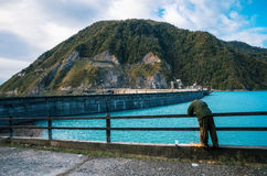 Worker carries repair work on the Enguri hydroelectric dam HES Stock Image