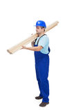 Worker carries wooden planks Stock Photos