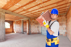 Worker carry brick on construction site Stock Photos