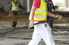 Worker carrying armature Royalty Free Stock Photography