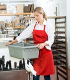 Worker Carrying Basket At Butcher's Shop Royalty Free Stock Photo