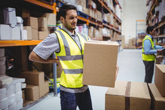 Worker carrying box with back ache Royalty Free Stock Photography