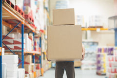 Worker carrying boxes in warehouse Stock Photos