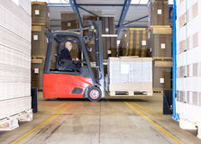 Worker Carrying Goods On Forklift Stock Photo