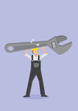 Worker Carrying Huge Adjustable Wrench Spanner Royalty Free Stock Photography