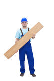 Worker carrying laminate flooring Stock Images