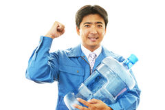 Worker carrying large water bottle. royalty free stock images