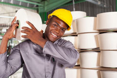 Worker carrying raw material. Textile factory worker carrying raw material on his shoulder Royalty Free Stock Photo