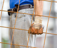 Worker carrying reinforcement mesh Royalty Free Stock Image