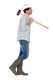 Worker carrying sledge hammer Royalty Free Stock Photography
