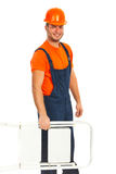 Worker carrying step ladder Stock Photography