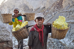 Worker carrying sulfur inside Kawah Ijen crater. Indonesia Stock Photo