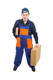 A worker carrying two cardboard boxes Royalty Free Stock Images