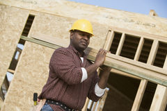 Worker Carrying Wooden Beam On Shoulder Stock Images