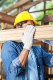 Worker Carrying Wooden Planks At Site Stock Image