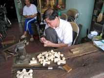 Worker carving seals Royalty Free Stock Images