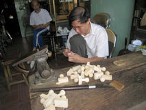 Worker carving seals Stock Photos