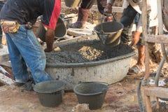 Worker. Casting concrete at construction site Stock Photos