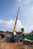 Worker casting concrete slab with mobile crane to build a house Royalty Free Stock Images