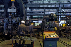 Worker cater for equipment. In the steel producing workshop royalty free stock image
