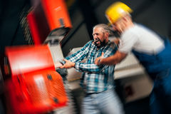 Worker caught in the machine and seriously injured Royalty Free Stock Image