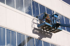Worker Caulking Office Windows Stock Photos