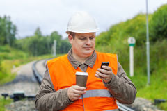Worker with cell phone Stock Images