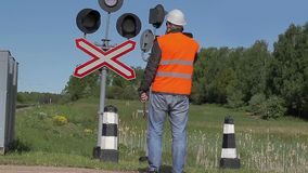 Worker with cell phone near the railway stock video footage