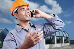 Worker With A cellphone Royalty Free Stock Photography