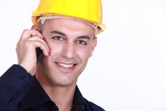 Worker with a cellphone Stock Image