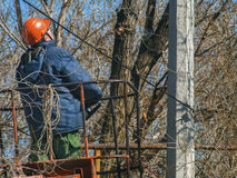 Worker changes old electrical wires royalty free stock photography