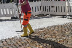 Worker is changing the pavement tiles. Street improvement. royalty free stock photo